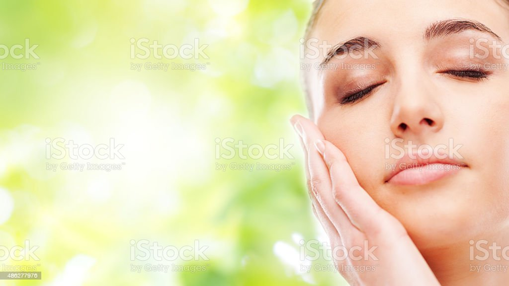 Beautiful woman touching her smooth skin stock photo