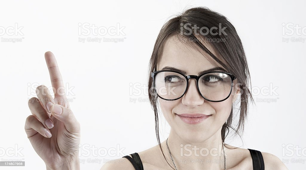 Beautiful woman touching with finger stock photo
