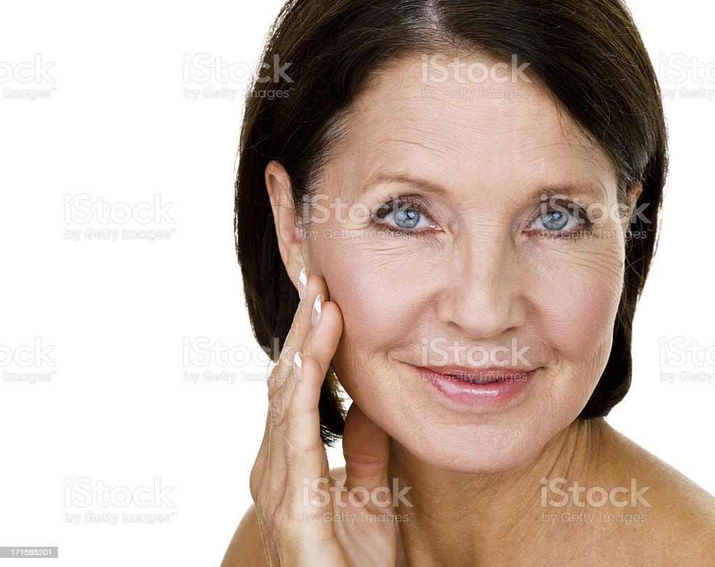 Beautiful woman touting her face royalty-free stock photo