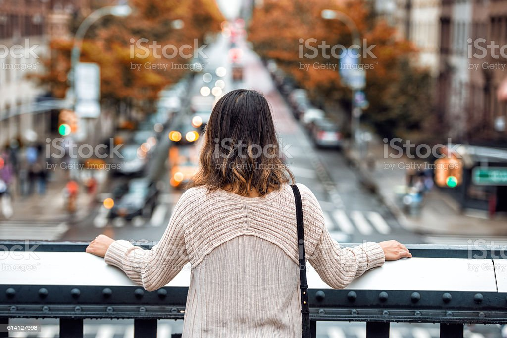 Beautiful woman travel and looking at New York City street stock photo