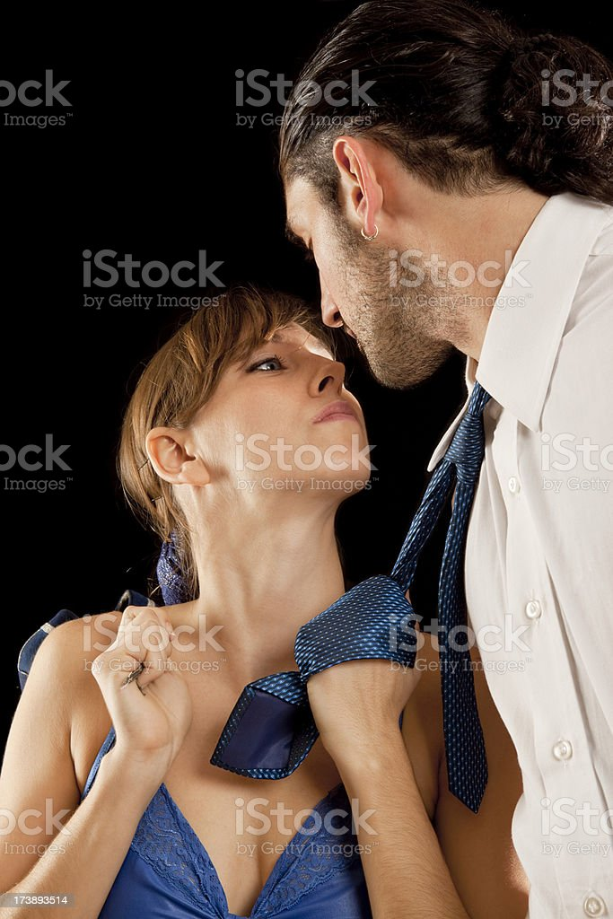 Beautiful woman trying to kiss a man stock photo