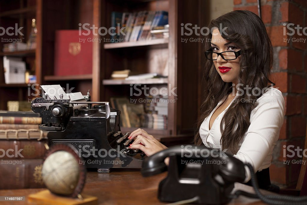 Beautiful woman typing on the old typewriter royalty-free stock photo
