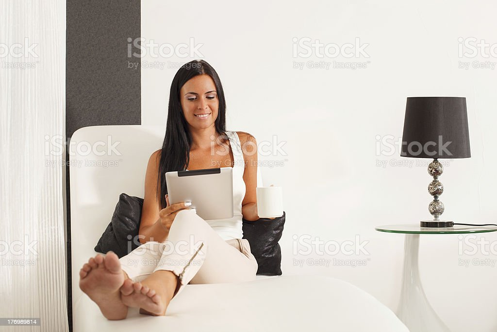 Beautiful woman using a digital tablet royalty-free stock photo