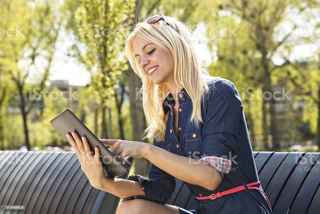 Beautiful woman using digital tablet royalty-free stock photo
