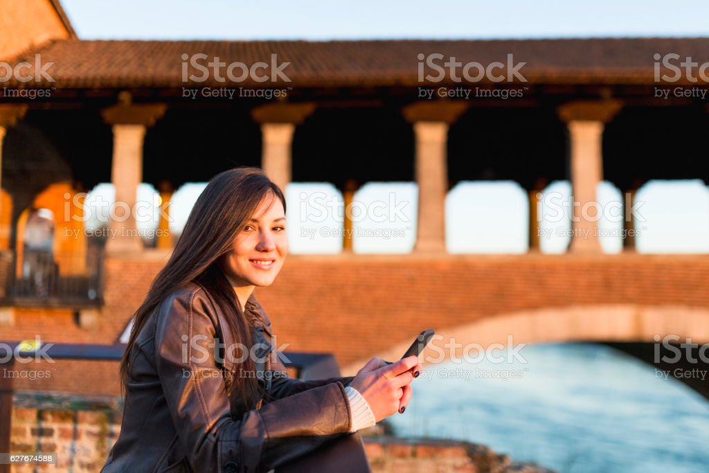 Beautiful woman using phone stock photo