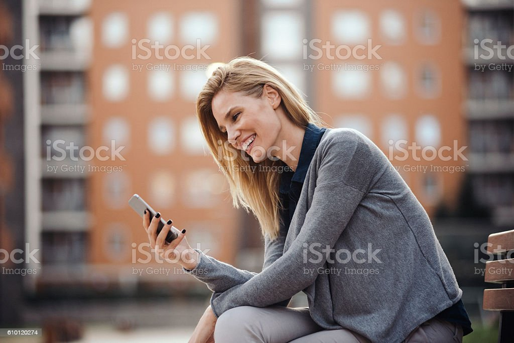 Beautiful woman using smartphone stock photo