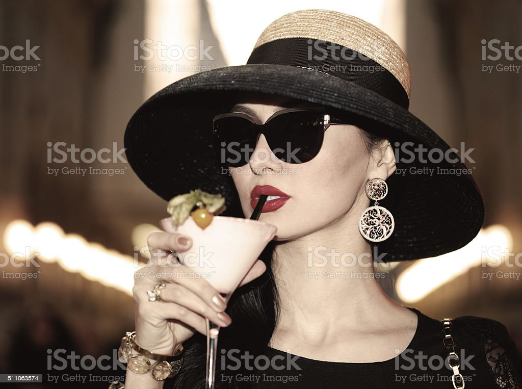 Beautiful woman vintage portrait drinking aperitif stock photo