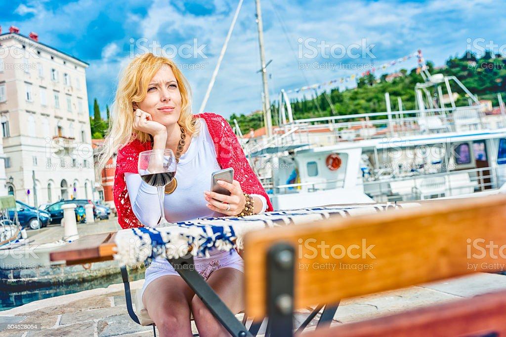 Beautiful woman waiting alone in restaurant stock photo