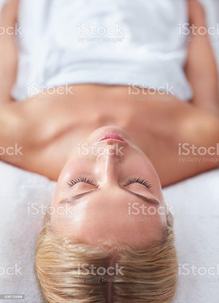 Beautiful woman waiting for massage at wellness spa stock photo