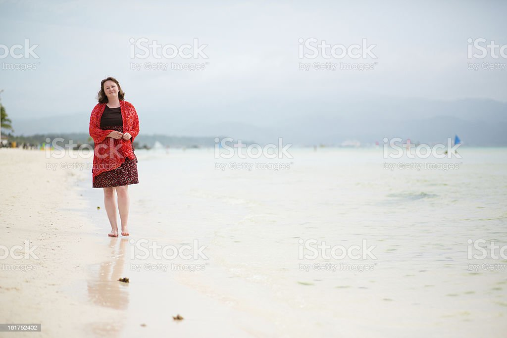 Beautiful woman walking by perfect white sand beach in Boracay royalty-free stock photo