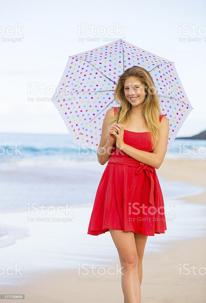 Beautiful Woman Walking on Tropical Beach stock photo