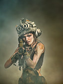 Beautiful woman warrior in a helmet with arms