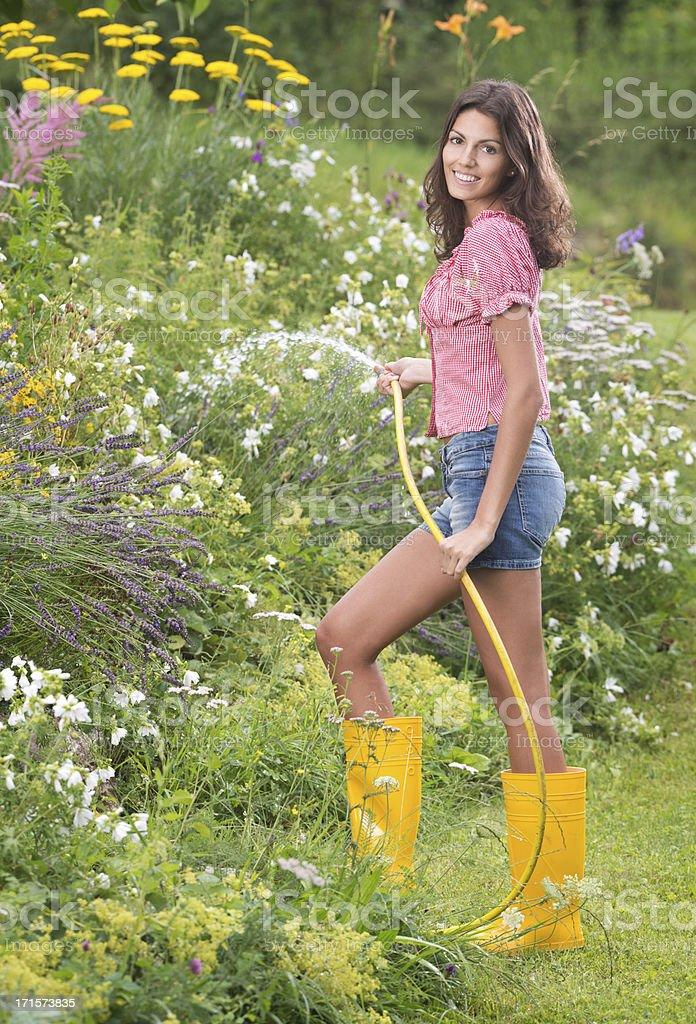 Beautiful Woman watering the Flower Garden (XXXL) stock photo