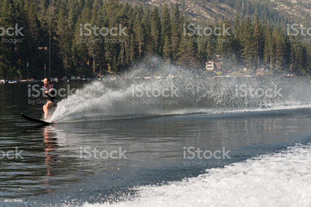 Beautiful woman waterskiing stock photo