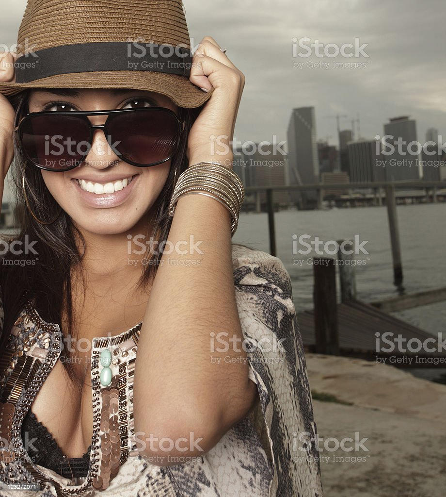 Beautiful woman wearing a hat and sunglasses royalty-free stock photo