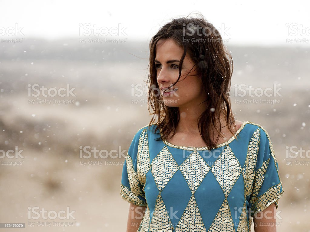 Beautiful woman wearing blue and gold shirt in the snow royalty-free stock photo