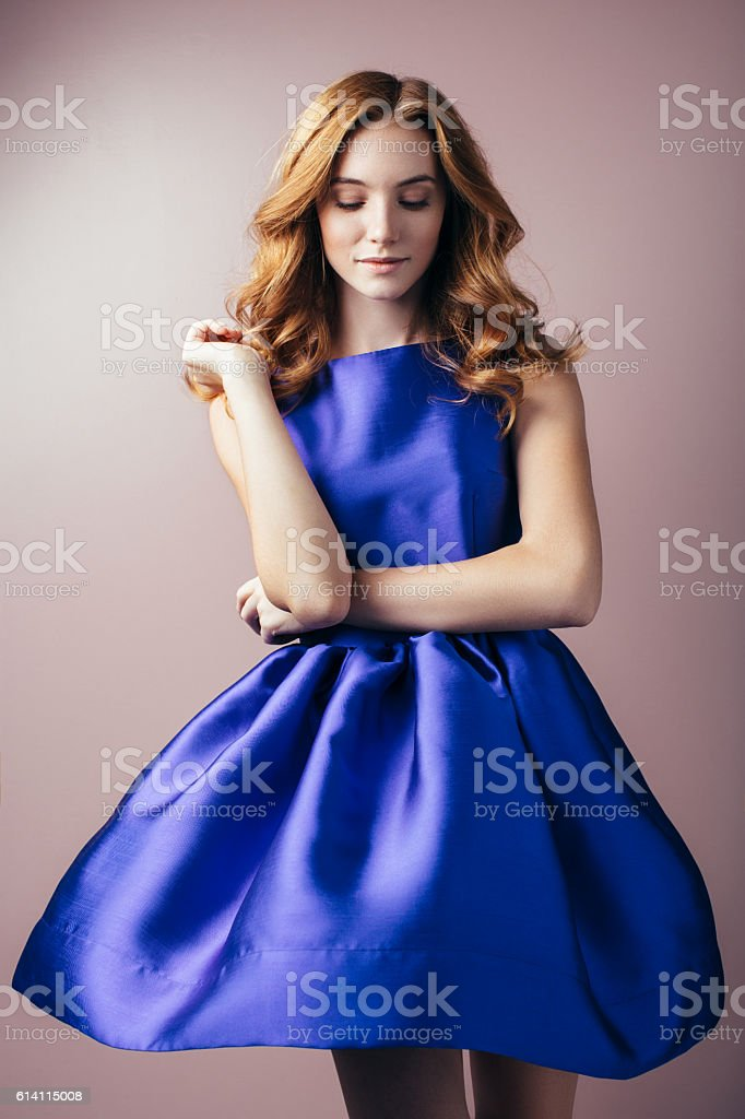 Beautiful woman wearing blue dress stock photo