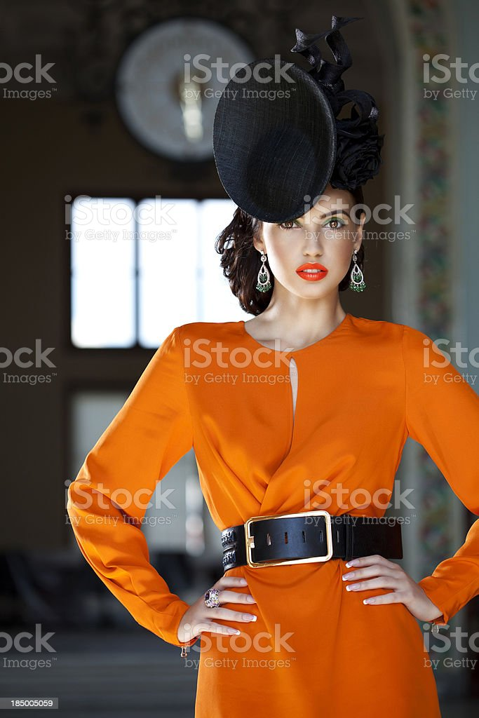 Beautiful woman wearing clothes and accessories haute couture royalty-free stock photo