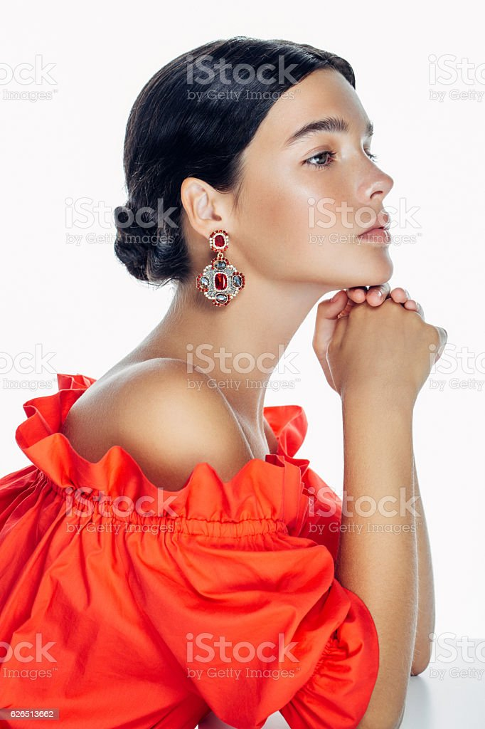 Beautiful woman wearing clothes and jewelry haute couture stock photo