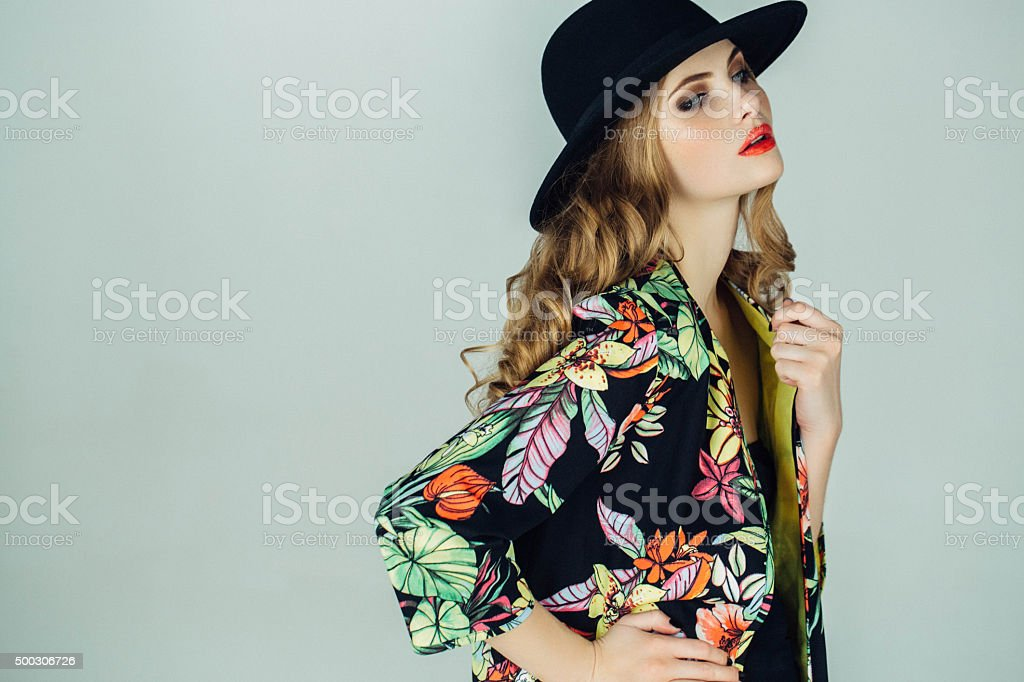 Beautiful woman wearing clothes haute couture stock photo