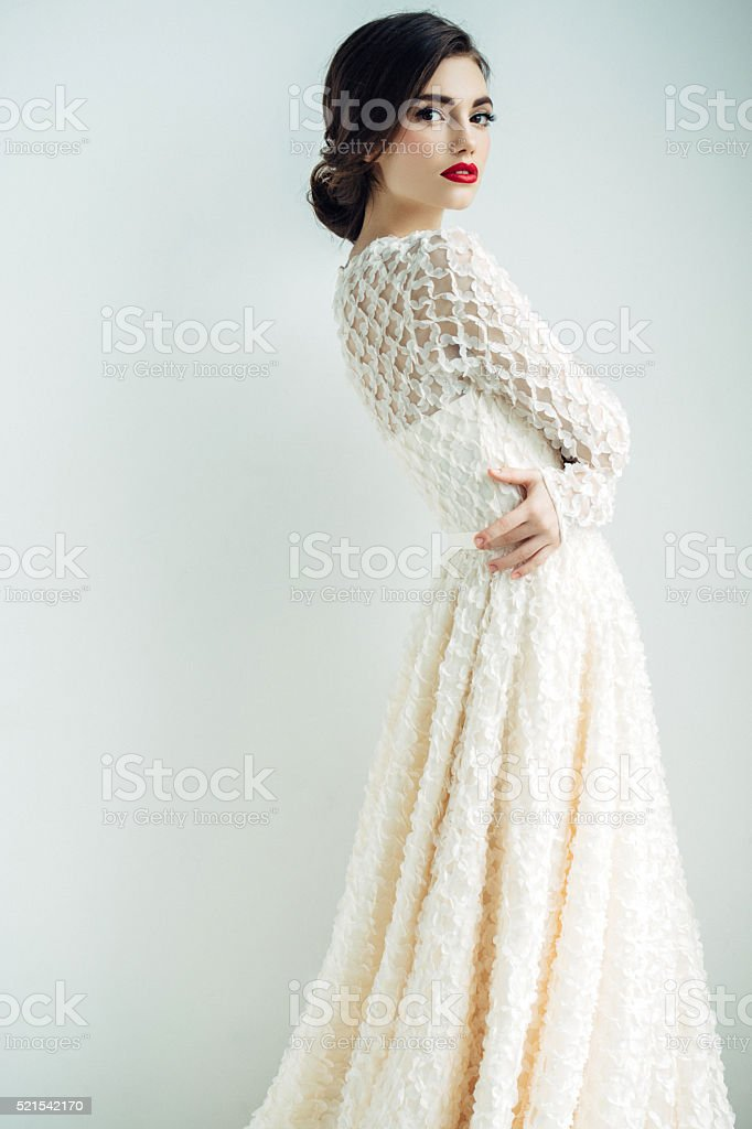 Beautiful woman wearing cocktail dress stock photo