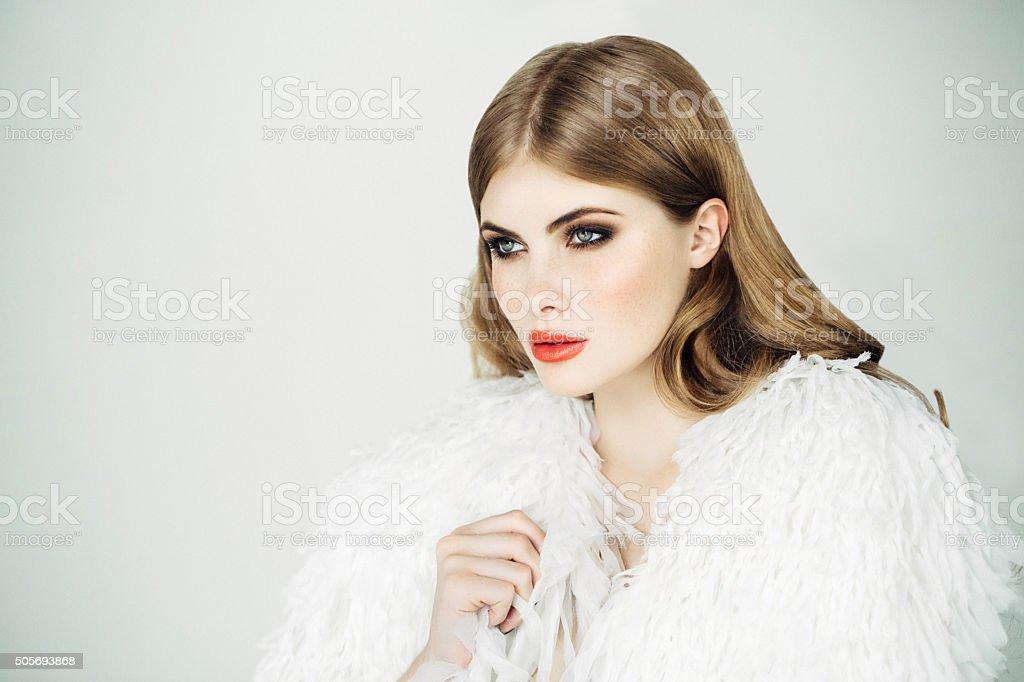 Beautiful woman wearing fur blouse stock photo