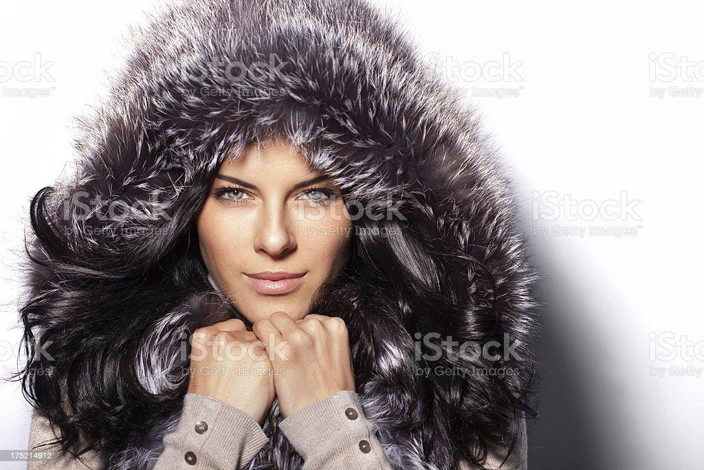 Beautiful woman wearing fur hood stock photo