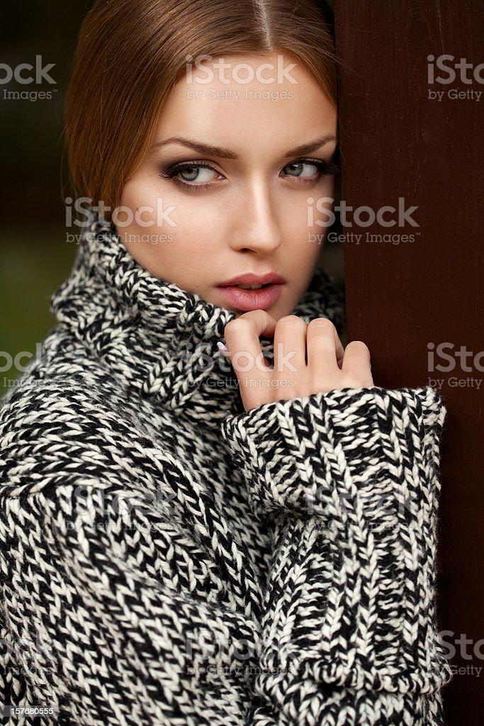 Beautiful woman wearing gray sweater royalty-free stock photo