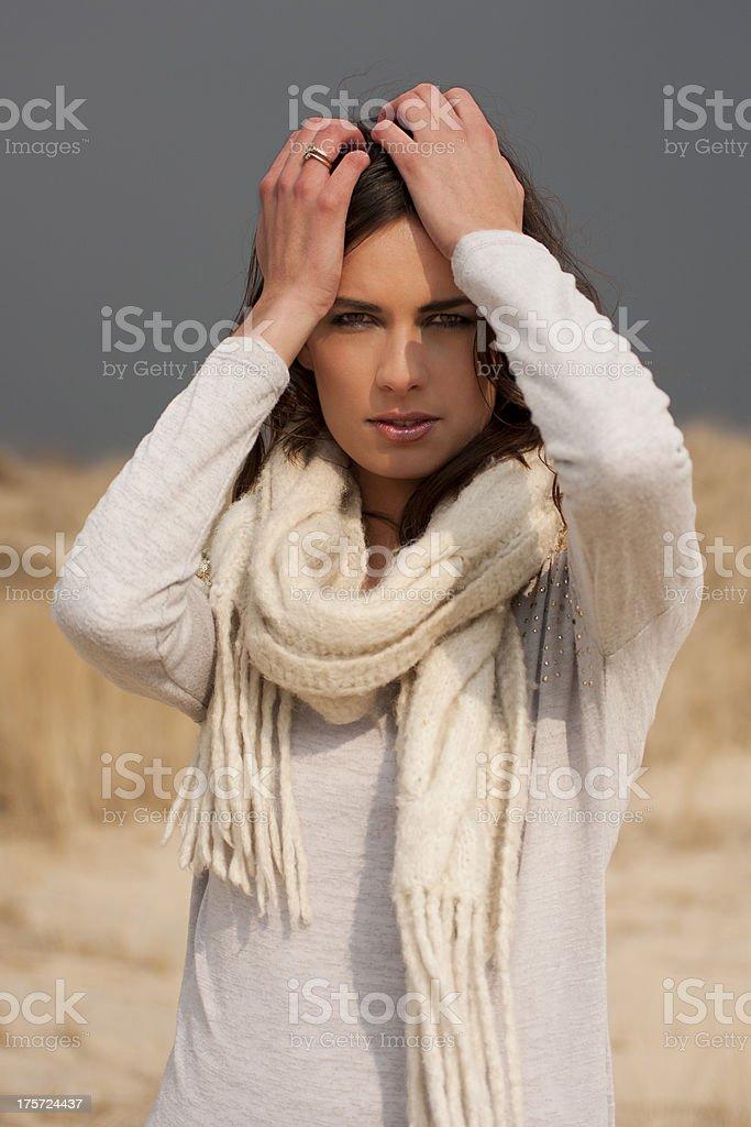 Beautiful woman wearing grey shirt and white scarf royalty-free stock photo