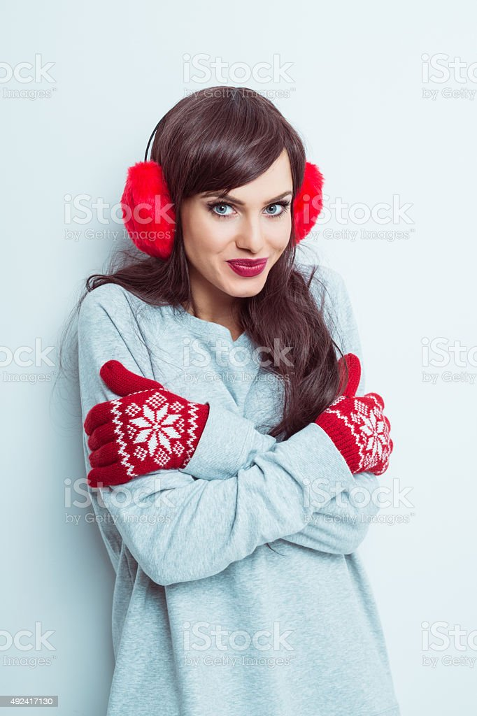 Beautiful woman wearing red earmuffs and gloves stock photo