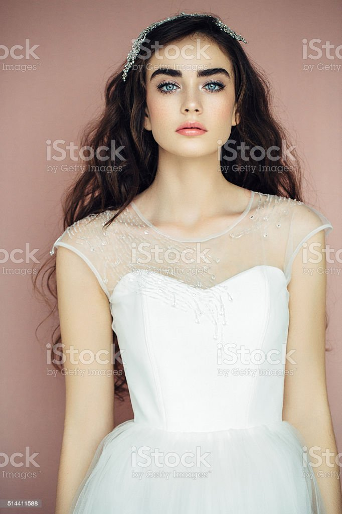 Beautiful woman wearing wedding dress stock photo