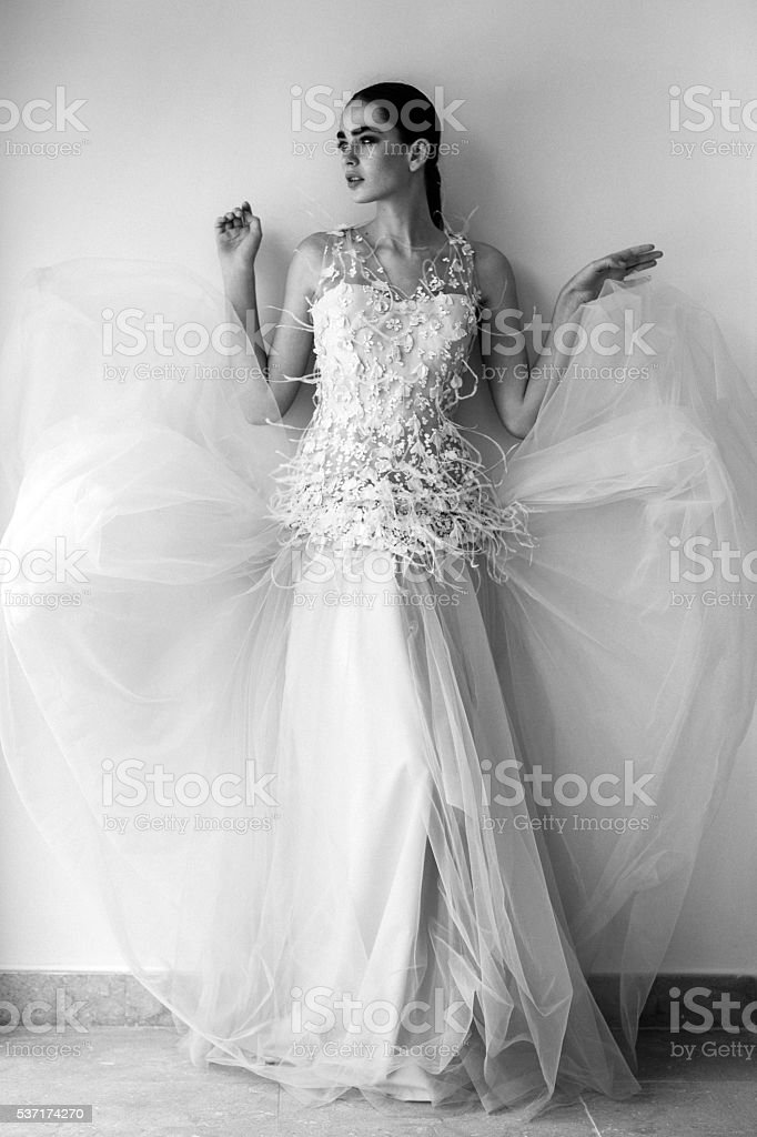 Beautiful woman wearing wedding dress stock photo