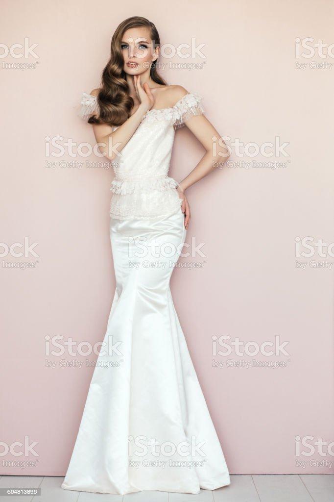 Beautiful woman wearing white dress stock photo