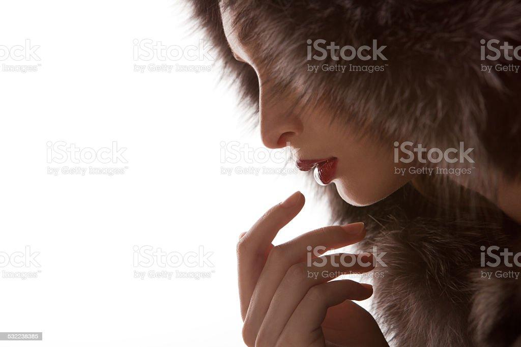 Beautiful Woman Wearing Winter Fur Jacket stock photo
