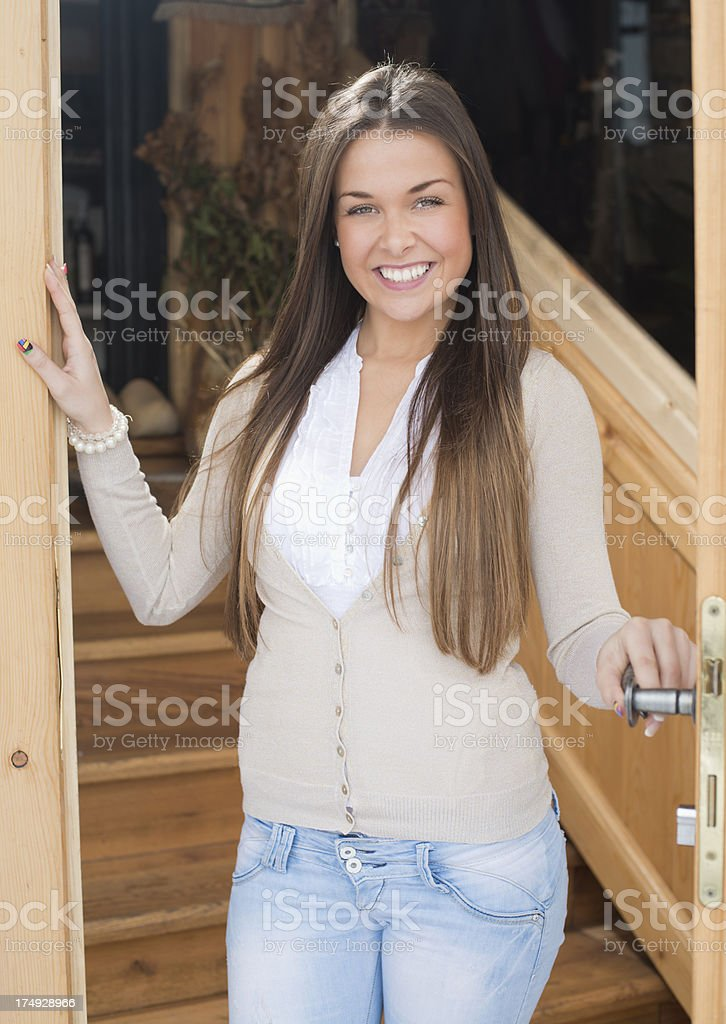 Beautiful woman wish a welcome royalty-free stock photo