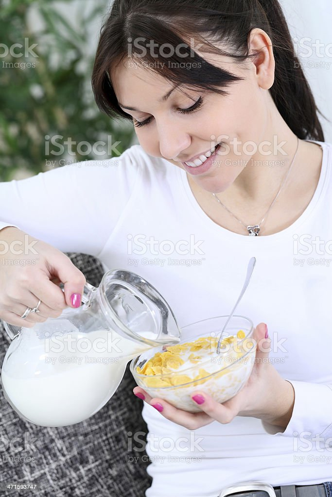 beautiful woman with a bowl of cereal royalty-free stock photo