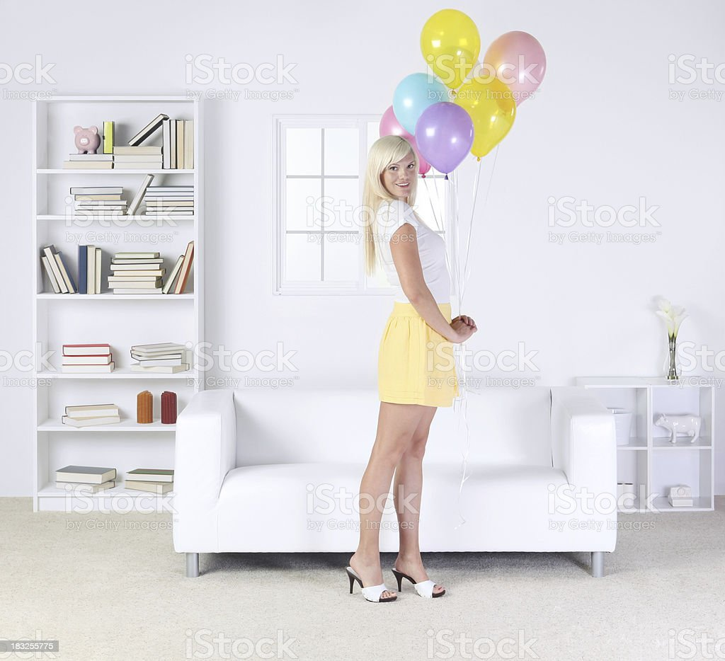 Beautiful woman with a bunch of balloons royalty-free stock photo