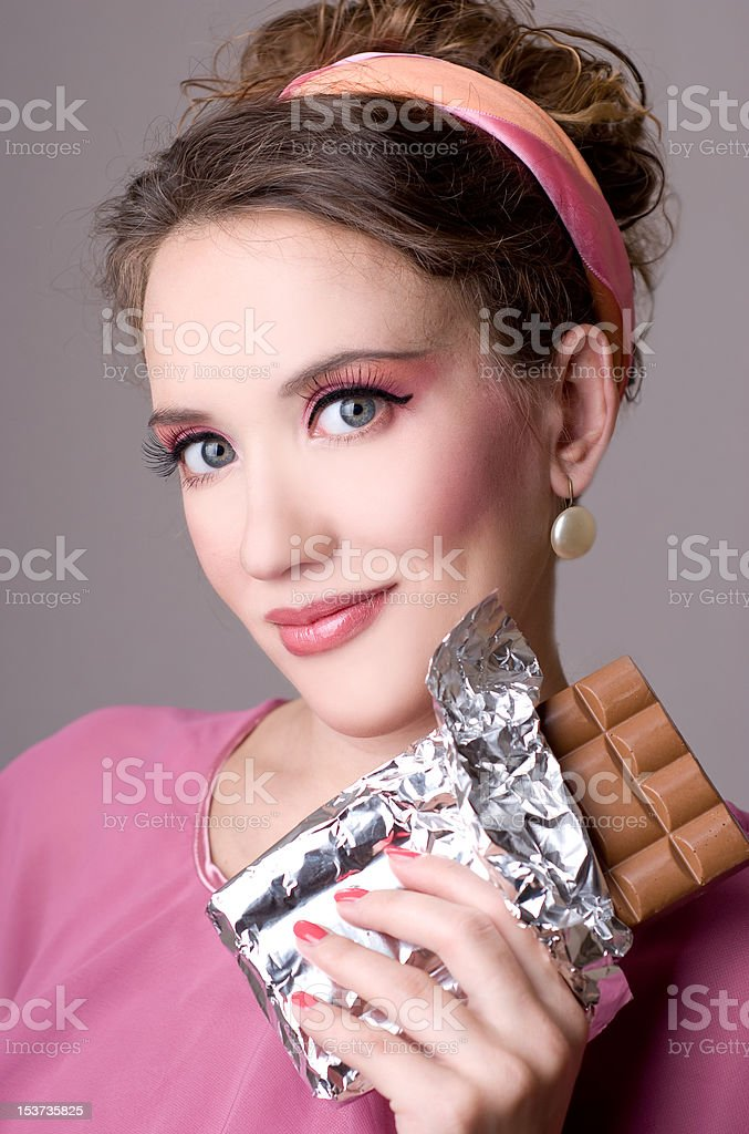 beautiful woman with a chocolate royalty-free stock photo
