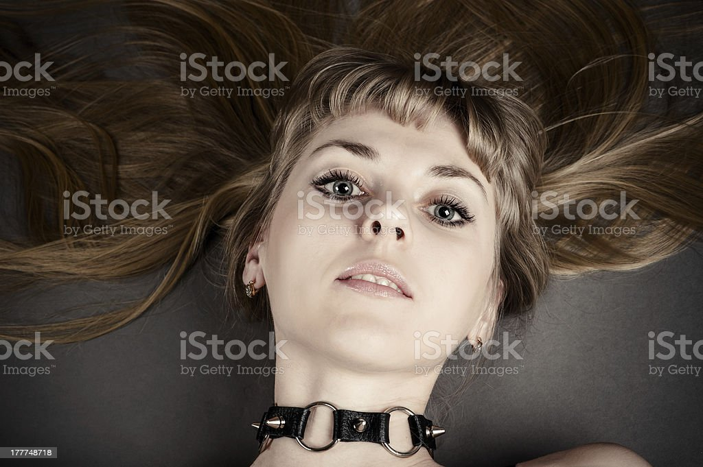 beautiful woman with a collar royalty-free stock photo