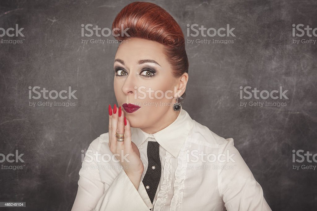 Beautiful woman with a confused expression stock photo