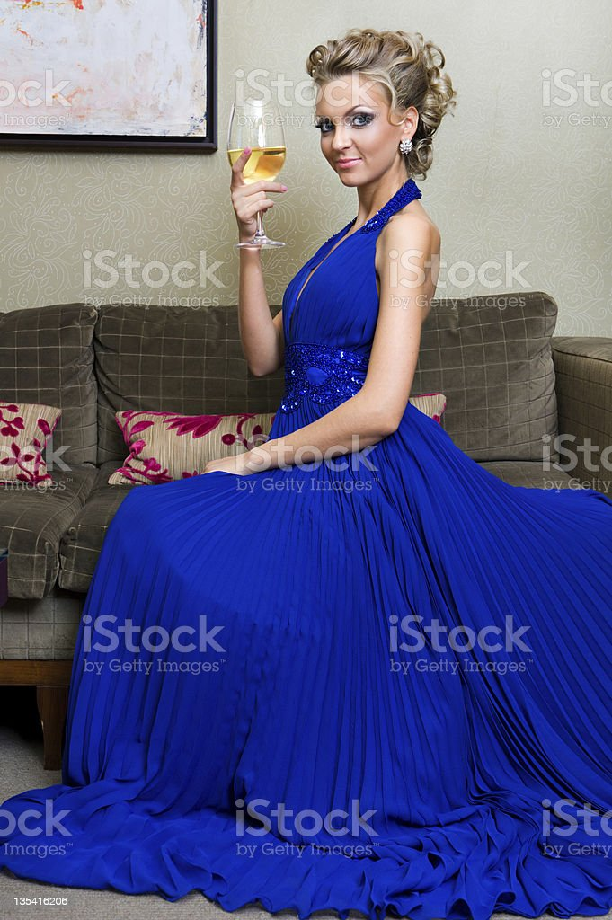 Beautiful woman with a glass of wine royalty-free stock photo