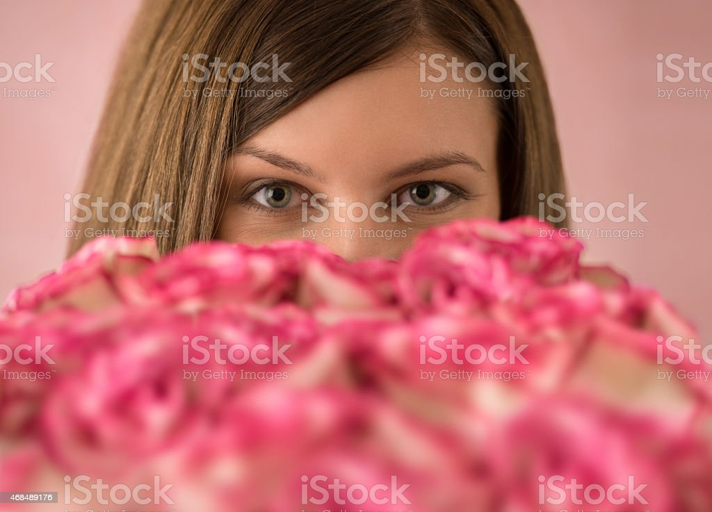 Beautiful woman with a large bouquet of flowers stock photo