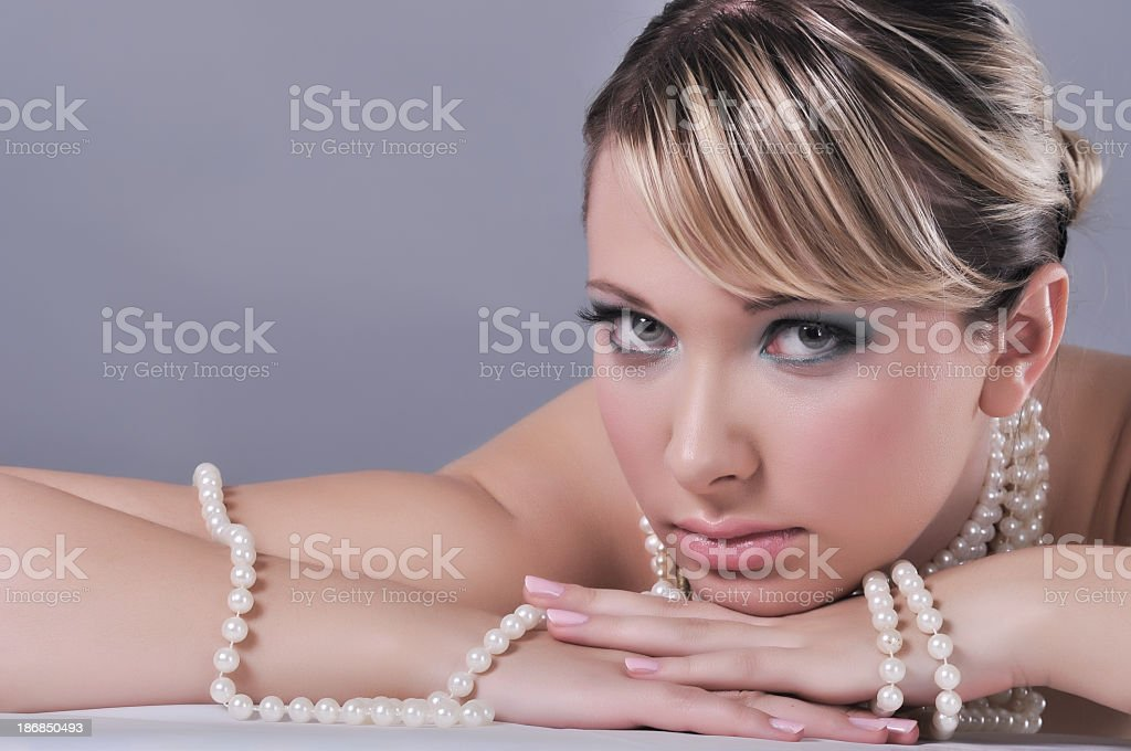 Beautiful woman with a pearl necklace stock photo
