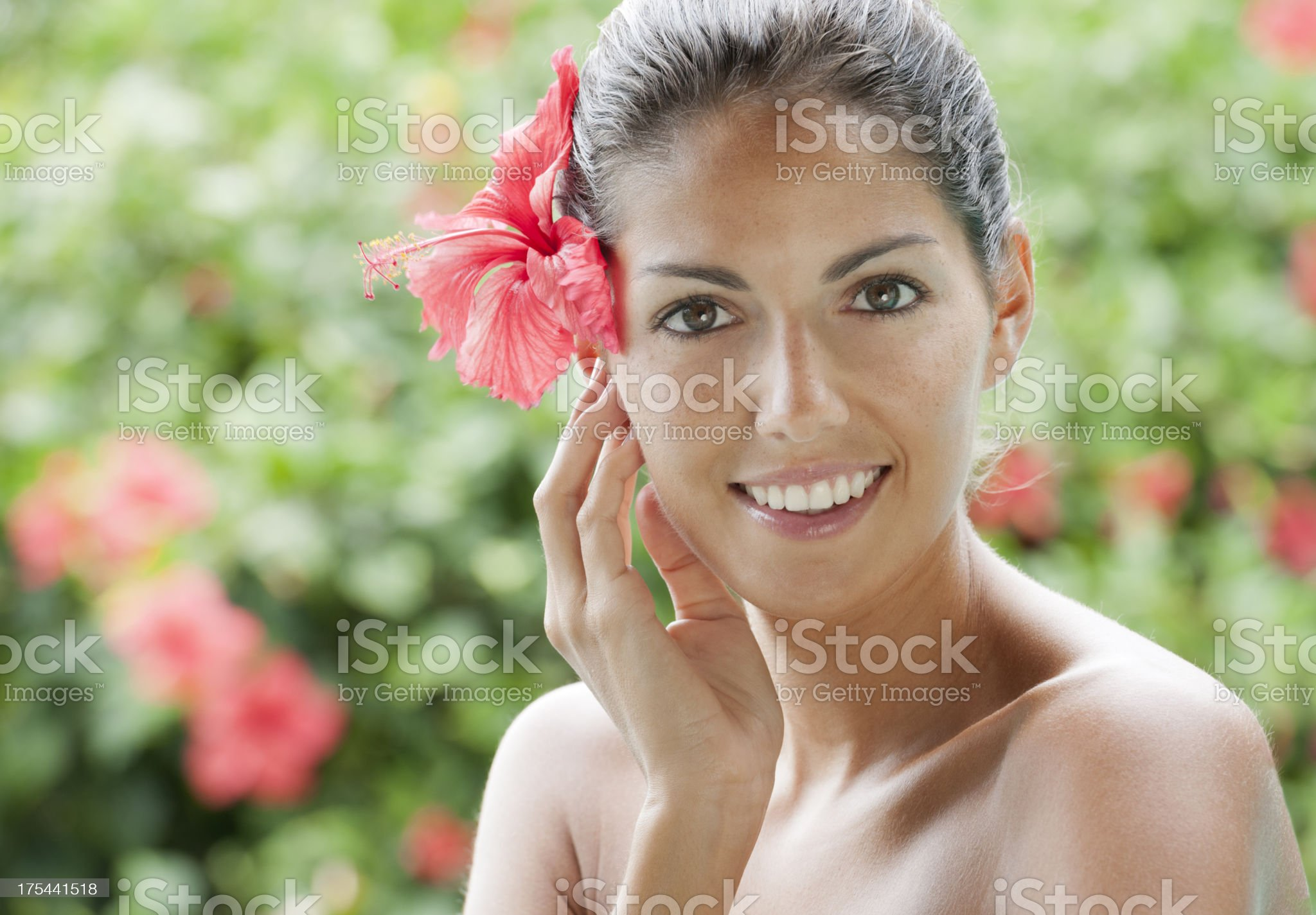 Beautiful woman with a red Hibiscus in her Hair (XXXL) royalty-free stock photo