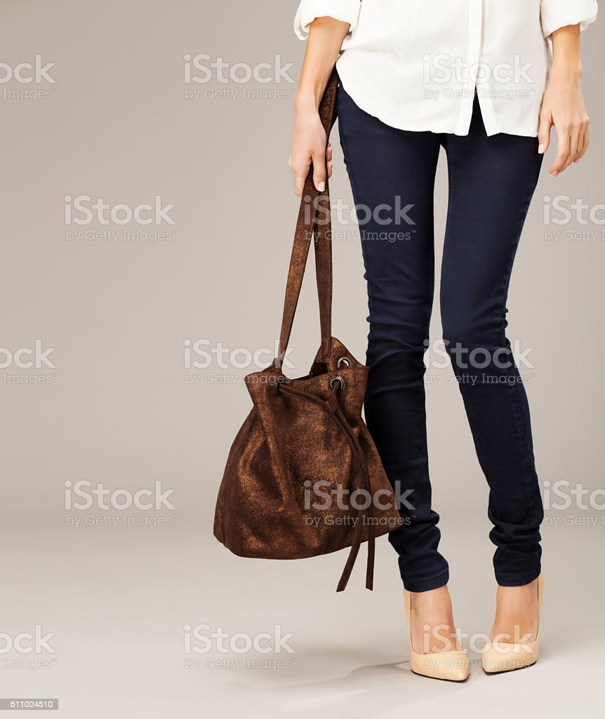 Beautiful woman with a silver fashion bag stock photo