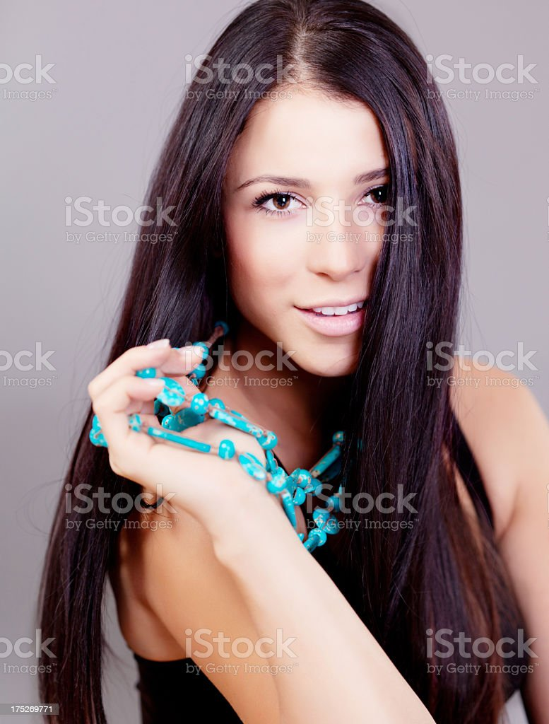 Beautiful woman with a turqouise necklace royalty-free stock photo