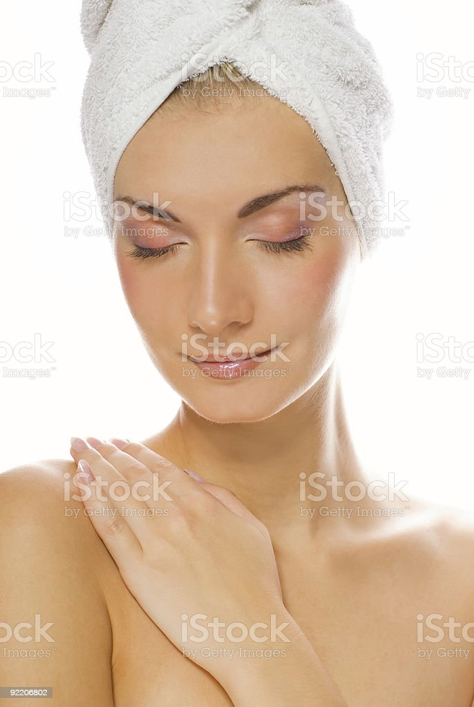 Beautiful woman with a white towel on her head royalty-free stock photo