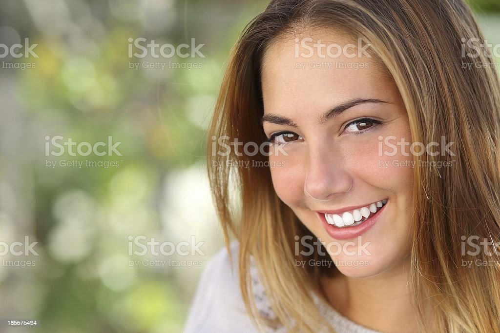 Beautiful woman with a whiten perfect smile stock photo