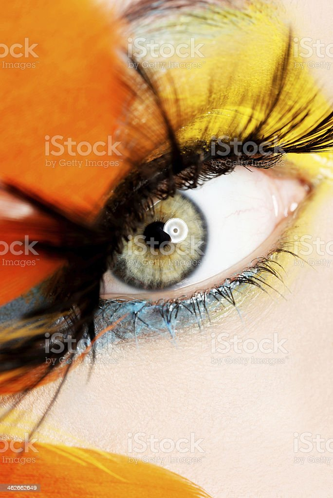 Beautiful woman with abstract make up. stock photo