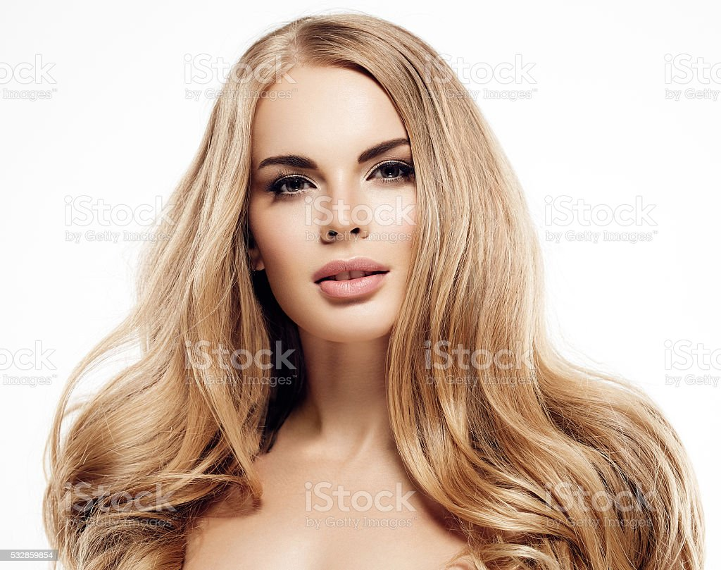 Beautiful woman with amazing curly long blonde hair stock photo